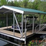 sun tracker pontoon docked in covered slip