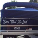 sun tracker pontoon with snap on cover and custom letters doin' what she likes
