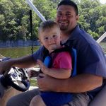 father and son on sun tracker pontoon