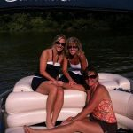 ladies on sun tracker pontoon enjoying fun in the sun