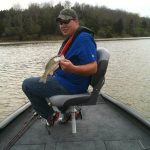 bass caught on front deck bow of tracker aluminum bass fishing boat