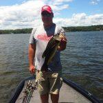 big largemouth bass on tracker aluminum bass fishing boat