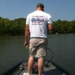 Grant wearing his new Stokley's tee shirt on their new Tracker boat