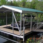 sun tracker pontoon docked in covered slip